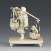 """A fine quality 4 1/2"""" ivory okimono of a fisherman returning home with his catch, his son disturbing"""