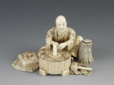 """An ivory okimono of a craftsman at his work with tools signed Shumei 3"""" x 2""""h"""