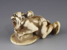 An ivory netsuke of a rat catcher