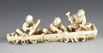 "An ivory okimono of three jolly men making a boat 4"" x 1 1/2"""