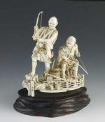 "A fine ivory okimono of two fishermen signed Gyokuzan 5"" x 6"""