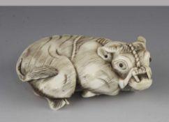 "A 3"" ivory netsuke of a recumbent ox"