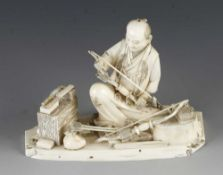 """A 3"""" ivory okimono of a fletcher or bow and arrow maker with his tools"""