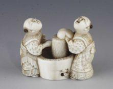 An ivory netsuke of two washerwomen