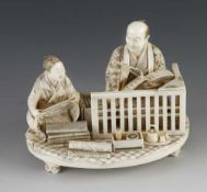 """A fine ivory okimono of a draper taking notes as his apprentice measures the cloth 5"""" x 4"""""""