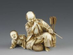 """A 3"""" ivory okimono of a fletcher checking his arrows with his playful son"""