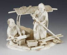 """An ivory okimono of two carpenters building a sedan chair 6"""" x 4""""h"""