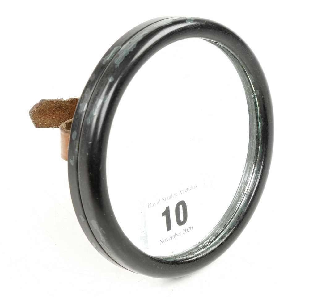 An unusual WW2 wrist signalling mirror in bakelite with leather strap G++