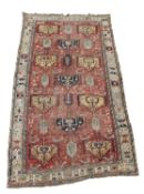 A Soumakh carpet, East Caucasus, the madder field with polychrome medallions, animals and guls,
