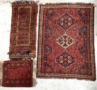 A Shiraz rug, South West Persia, madder field with a triple linked polychrome medallion within