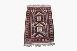 A Belouch prayer rug, the polychrome mihrab with hooked guls and motifs, within an ivory