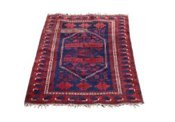 A Belouch rug, the indigo field with a large hexagonal stepped medallion, with guls and stylised