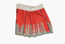 A Chinese silk embroidered skirt, Qing Period, with sea creatures and waves, length 96cm, width of