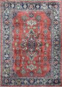 A Mahal Carpet, West Persia, the madder field with a polychrome lobed medallion, flowerheads and