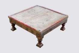 An Indian low table, the frieze with mounted brass flowerheads, on turned legs, height 21.5cm,