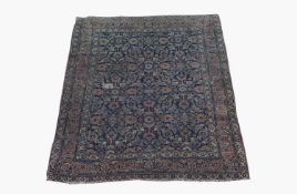 A Khorassan rug, North East Persia, the indigo field with all over herati design, within a madder
