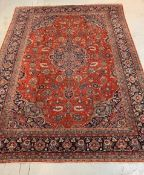A Kashan Carpet, West Persia, the madder field with a central indigo lobed pole medallion, with