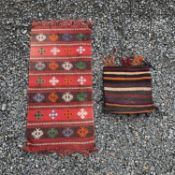 A Belouch bag, with kelim back, the indigo field with a hooked medallion within an ivory