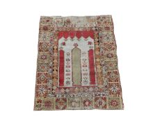 A Turkish prayer rug, the ivory mihrab within a yellow border with large flowerheads and guls, 146 x