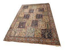 A machine made carpet, of Baktihari Persian design, the polychrome compartment field decorated