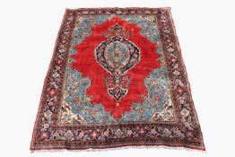 A Mahal carpet, West Persia, the madder field with a central polychrome lobed medallion, within an