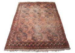 An Afghan Ersari carpet, the camel field with six rows of three octagonal medallions, within a