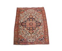 A Sarough rug, West Persia, the ivory field with an indigo central medallion, with palmettes and