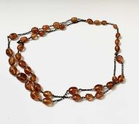 A long necklace of amber beads, length 73cm.Condition report: The beads are various sizes the