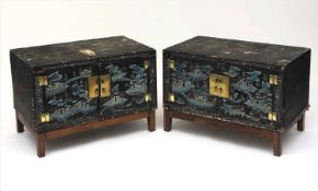 A pair of Chinese lacquered wood and painted cabinets, early 20th century, on later oak stands,