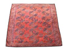 An Turkoman Ersari carpet, the madder field with six rows of three octagonal medallions and