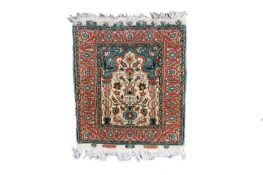 A Turkish silk mat, with label inscribed 'Istanbul-Cinar, Pure Silk', the ivory mihrab with a