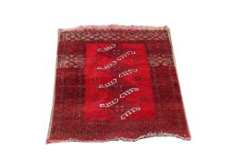 An Afghan rug, the madder field with four hooked guls, within multiple borders, 128 x 95cm.