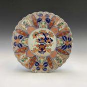 A Japanese Imari porcelain charger, late 19th century, diameter 31cm.