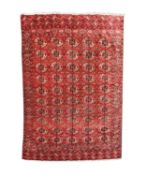 A Tekke carpet, Turkmenistan, circa 1890, the madder field with ten rows of five medallions,