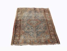 A Kashan rug, Central Persia, the indigo field with a polychrome central pole medallion with