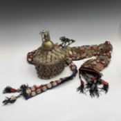A Central Asian headdress, with metal mounts and semi precious stones.