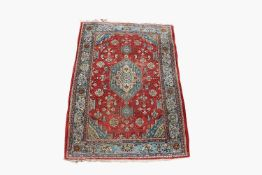 A Tabriz rug, North West Persia, the madder field with a sky blue and ivory central medallion,