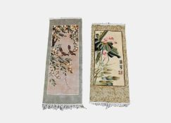 Two Chinese rugs, one with calligraphy and seal mark, 123 x 47cm and 110 x 46cm.