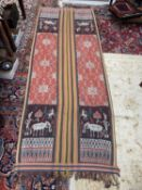 A warp Ikat cotton weaving, Sumatra, Indonesia, decorated with a figure holding an umbrella and a