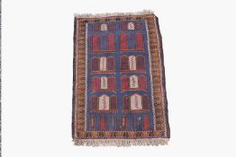 An Afghan Belouch rug, the indigo field with rows of polychrome motifs within a camel hooked gul