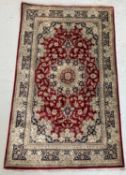 A Qum silk rug, Central Persia, with cartouche to one end enclosing an Islamic inscription, the