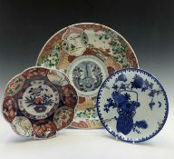 A Japanese imari charger, late 19th century, diameter 36.5cm, and two Japanese dishes, diameter 24.