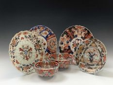 Three Japanese Imari chargers, 19th century, largest 31.5cm, a Japanese Imari dish, 24.5cm and two