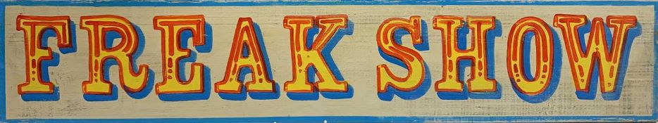 A sign written wooden sign 'FREAK SHOW'. 20 x 105.5cm. Condition report: A reclaimed wooden plank
