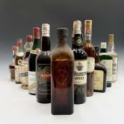 A selection of vintage bottles of Gin, fortified wine and other spirits.Condition report: The