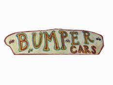 Simeon STAFFORD (b.1956) A sign written wooden sign 'BUMPER CARS'Signed 38 X 143.5cm (irregular)