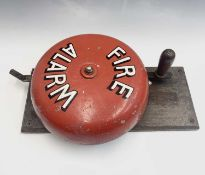 A vintage hand operated 'Fire Alarm' bell on a mahogany mount, height 46cm.
