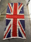 A collection of linen flags, to include three Union flags, St George, 97cm X 176cm, RNLI, Stars