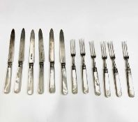 A set of six dessert knives and forks by Goldsmiths & Silversmiths Co Ltd pearl handles