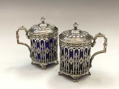 A pair of French silver pierced and embossed mustards with blue glass liners mustard pots 5.8oz